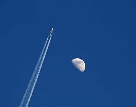 Jet with vapor trail photo