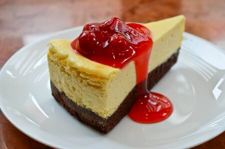 Cherry cheese cake in the plate