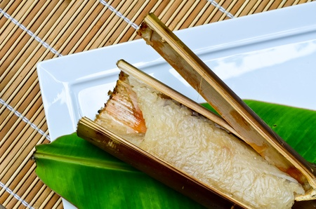 Glutinous rice roasted in bamboo joints photo