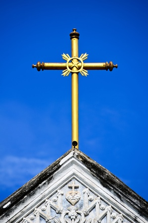 gold cross: Gold cross on top of the church Stock Photo