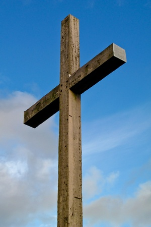 Wood cross with blue sky photo