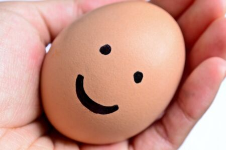 cilia: Smiling egg on hand Stock Photo