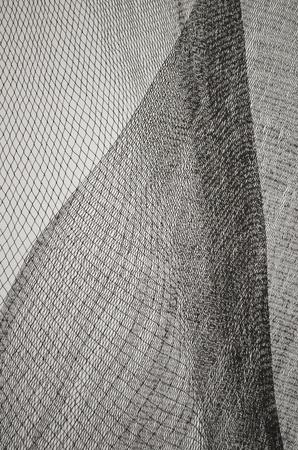 woven surface: Textura de red en blanco y negro verticales