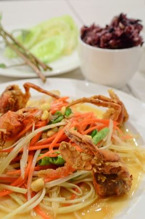 Thai papaya salad with fried crab photo