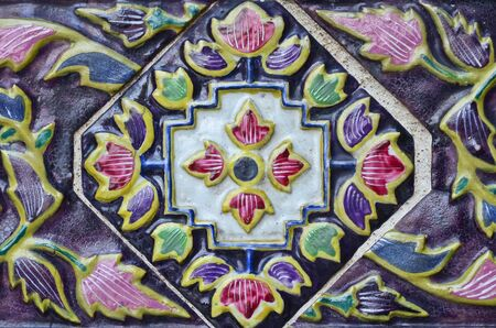 Colorful Thai style ceramic decoration at Wat Phra Kaew, Bangkok, Thailand Stock Photo