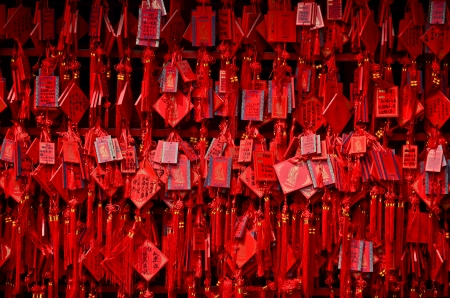 Wall covered with countless wish cards in a Buddhist temple in China