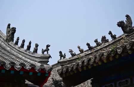 Statue of dragons on the roof of Chinese temple photo