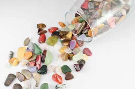 Close up color stones in the glass on white background