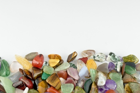 Close up color stones on white background photo