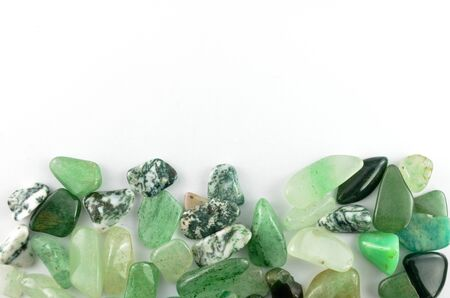 Green stones isolated on white background photo