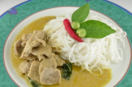 Thai pork green curry with rice noodles photo