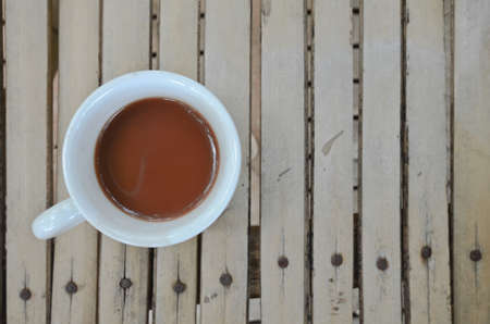 A cup of hot chocolate on wooden floor photo