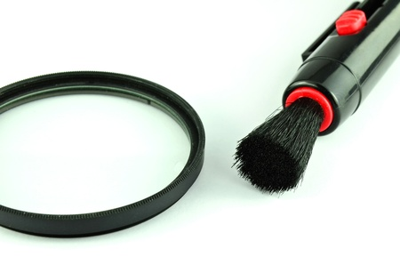 Pocket lens pen and brush for cleaning filter camera isolated on white background photo