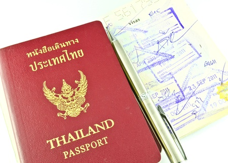 foreign national: Thai passport and immigration stapms Stock Photo