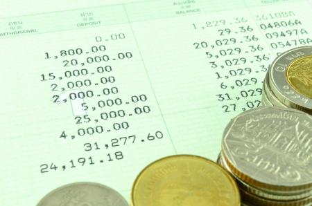 passbook: Saving Account Passbook with Thai coins Stock Photo