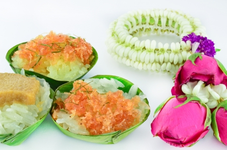 Thai style sweet desserts with Thai garland isolated photo