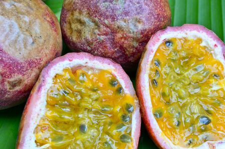 grenadilla: Passion fruit on green leaf background