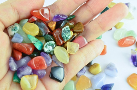 Hand holding colorful stones
