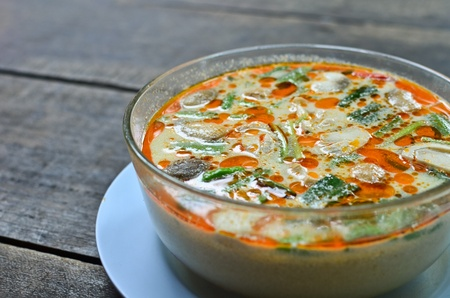 Bowl of spicy Thai Tom Yum soup photo