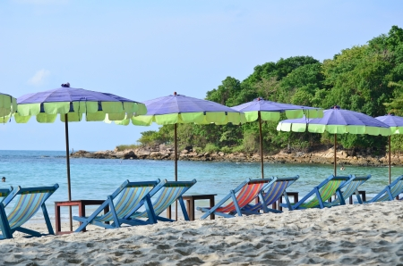 Canvas chair on the beach in thailand photo