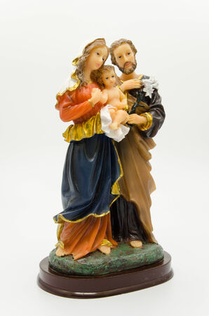 Holy family sculpture isolated photo