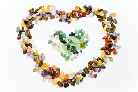 Colorful stones in heart shape isolated