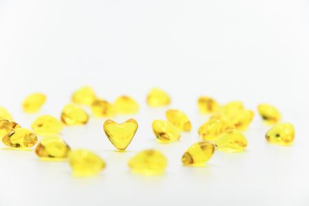 Heart shape vitamin isolated Stock Photo