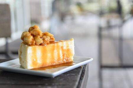 A piece of caramel cake with macadamia topping