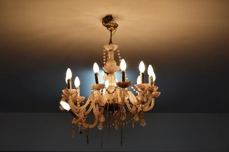 old broken ceiling lamp in night time