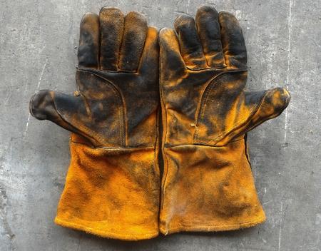 Detail glove after work hard on dirty cement ground