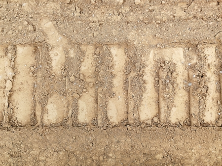 tire track of vehicle on soil road in countryside Stock Photo