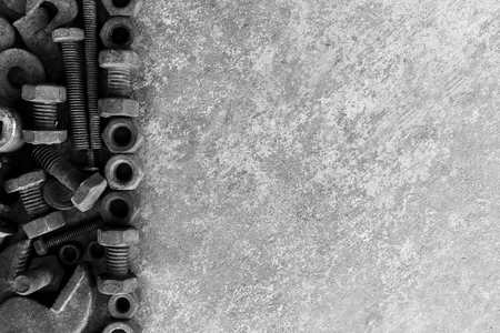 many rust steel on cement ground in black and white photography