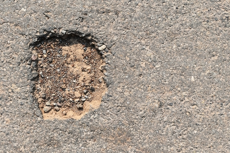 hole on asphalt road in countryside