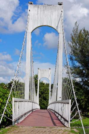 garden city: White bridge in a green garden city.