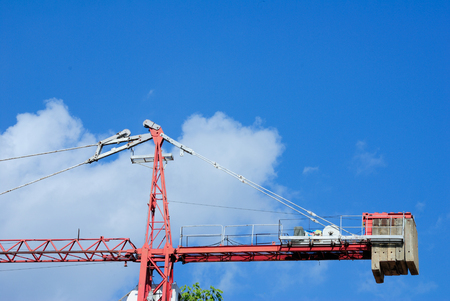 jib: Construction cranes close up against the blue sky Stock Photo