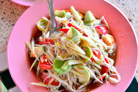 Green papaya salad Thai cuisine spicy delicious :  SOM TAM  Thai speak photo