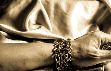 bondage: chain hands of a man