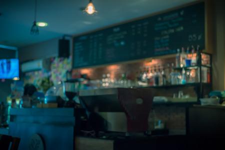 Attar: Blurred coffee shop.