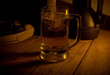 un bottled: Glass of light beer on a dark Stock Photo