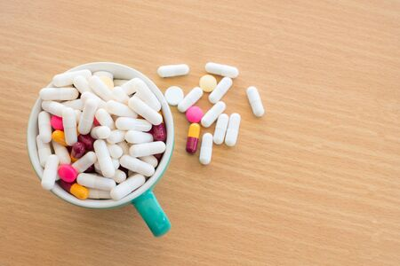 antidepressants: diferent Tablets pills capsule heap mix therapy drugs doctor flu antibiotic pharmacy medicine medical