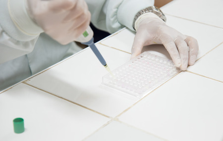 clinician: clinician studying chemical element in laboratory