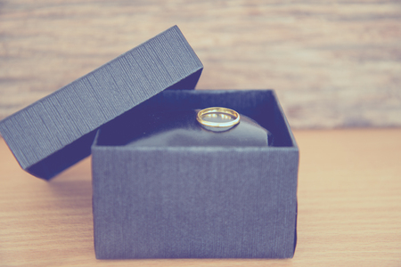 jewellry: ring in box in vintage tone.