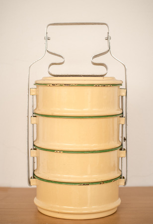 tiers: Yellow metal Tiffin,thai food carrier.vintage tone