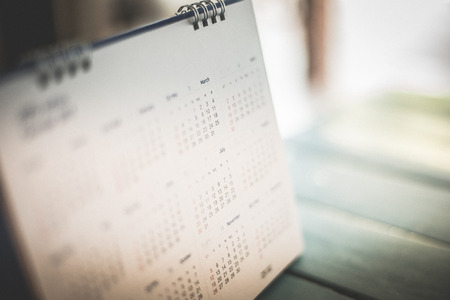 Blurred calendar page blue background. Standard-Bild