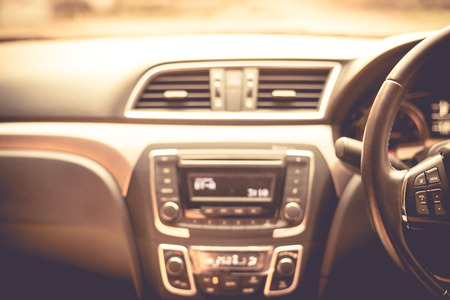 sumptuous: Blurred car Interior in pink tone. Stock Photo