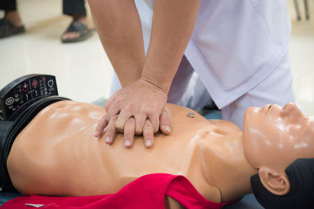 chest compression: rescue CPR training Stock Photo