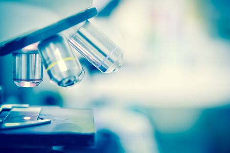 extracting: Scientist using  microscope in a laboratory