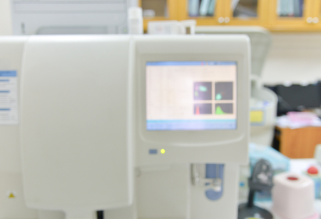 analytical chemistry: Blurred automate analyzer technology in laboratory.