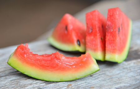 water melon: water melon on wood texture. Stock Photo