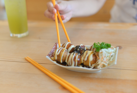 sushi with chopsticks and japanese food.